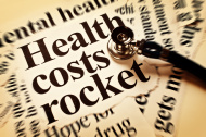 stock-photo-20937222-health-costs-rocket-says-sepia-toned-headline-with-stethoscope